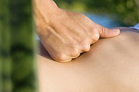 Massage therapist´s hand on patient´s abdomen, close-up