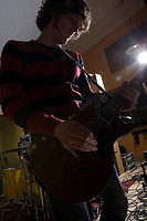 Guitarist playing in recording studio