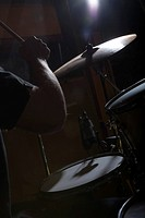 Drummer playing in recording studio