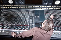 Producer adjusting sound equipment