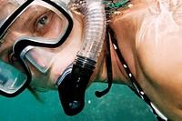 Reef woman snorkeling underwater in Red Sea