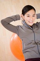 Asian woman exercising on ball