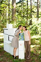 Businesswomen talking at water cooler in woods