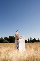 Businessman next to copier in field