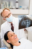 Male dentist examining womanÆs x-ray