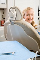 Girl sitting in dental chair