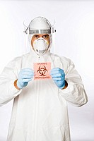 Man in clean suit holding biohazard sign