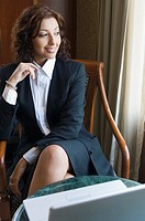 Businesswoman sitting in front of a laptop and smiling