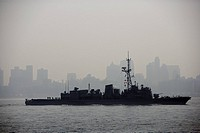 USA, New York City, silhouette of battle ship in Hudson River