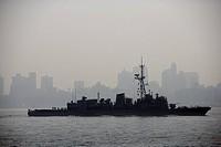 USA, New York City, silhouette of battle ship in Hudson River