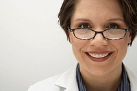 Female doctor wearing glasses, smiling, portrait