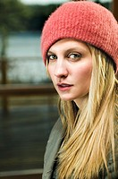 Young woman wearing winter hat, outdoors, portrait