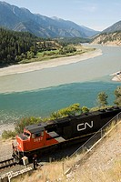 A canadian national train passes the confluence of the fraser and thompson rivers at lytton, thompson-okanagan, british columbia, canada