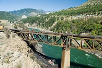 A canadian national train derailed on july 31, 2006 lies below a bridge over the thompson river, thompson-okanagan, british columbia, canada