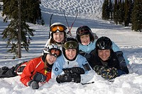 A family rests in between runs at Sun Peaks Ski Resort near Kamloops, British Columbia, Canada