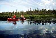 Couple canoeing in Prince Edward Island National Park, Canada