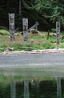 Haida Gwaii, Ninstints Village Nad Sdins, Anthony Island SGaang Gwaay, weathered mortuary totem poles, British Columbia, Canada