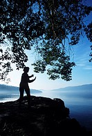 Single woman praticing Tai Chi on the shore, Vancouver Island, British Columbia, Canada