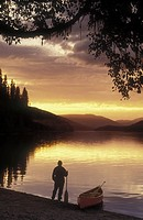 canoeist on Bowron Lakes, British Columbia, Canada