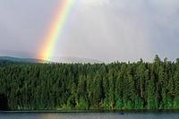 Rainbow spans across Dutch Lake, Clearwater, British Columbia, Canada
