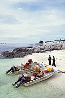 Salmon fishing boats at shore lunch, Dundas Island, Chatham Sound, British Columbia, Canada