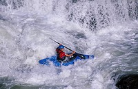 Man Kayaking in White Water