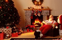 Santa Asleep by the Fireplace