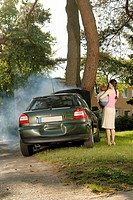 Car Crashed and Smoking on Tree with Mother and Child Watching