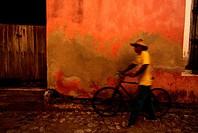 Man Pushing Bicycle