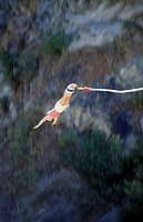 Young woman bungee jumping