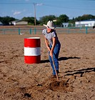 Cowgirl raking Dirt, Brandon, Manitoba Not