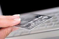 Woman holding bank card, close-up