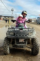 Woman and Child on ATV, Cambridge Bay, Nunavut