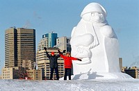 People beside Snow Sculpture during Festival du Voyageur, Winnipeg, Manitoba