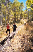 Man and Woman Jogging Through Aspens