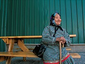 Woman Sitting on a Bench, Inuvik, North West Territories