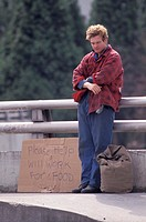 Homeless Man on Bridge