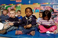 Four and Five Year Olds listening to a story in a classroom
