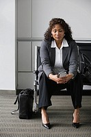 African businesswoman in waiting area