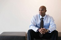 African businessman sitting on bench
