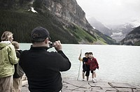 Tourists Photographing Lake Louise, Alberta