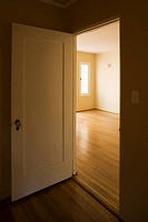 Door Open in Empty Yellow Room