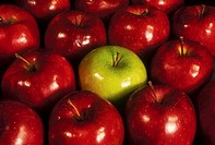 Green Apple Among Red Apples