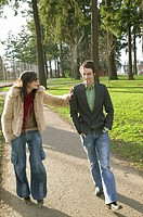 Attractive Urban Couple Walking Together In A City Park