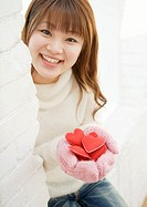 Woman Holding Heart Shaped Toy