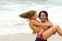 Young Man Holding Young Woman in Tide