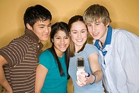 Diverse Teens Taking Group Portrait with Camera Phone