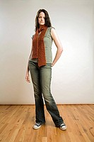 Woman with Orange Scarf and Jeans Standing in Photo Studio