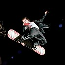 Young Man Snowboarding in a Suit and Tie