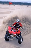 Four Wheeler Kicking Up Sand
